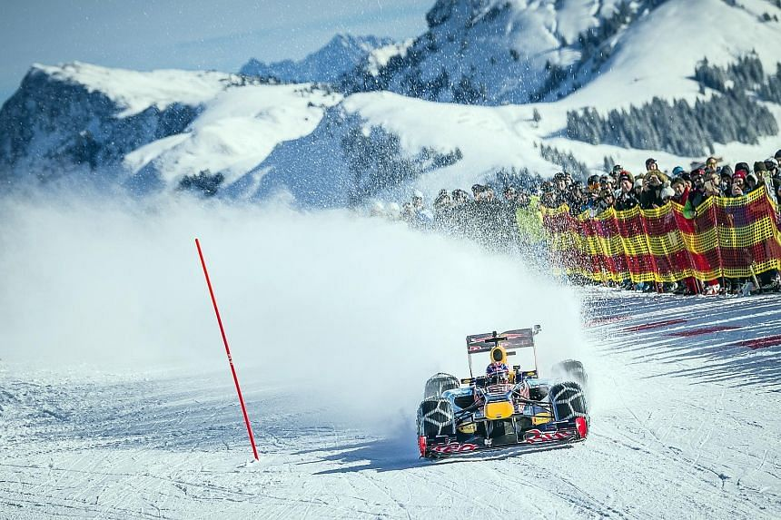 """A 3,500-strong crowd witnessed Toro Rosso driver Max Verstappen driving a Red Bull Formula One race car down a ski slope during the Formula One Showrun event at the Hahnenkamm ski races in Kitzbuehel, Austria on Thursday. """"It was really cool and was"""