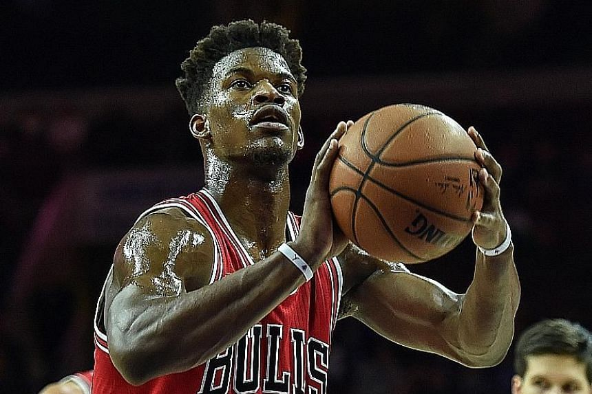 Chicago Bulls guard Jimmy Butler scored a career-high 53 points, 10 rebounds and six assists in the 115-111 overtime victory over Philadelphia.
