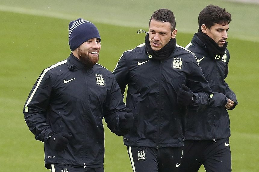 With Manchester City keeping a second successive clean sheet, Manuel Pellegrini may continue with Martin Demichelis (right) alongside Nicolas Otamendi in the heart of defence.