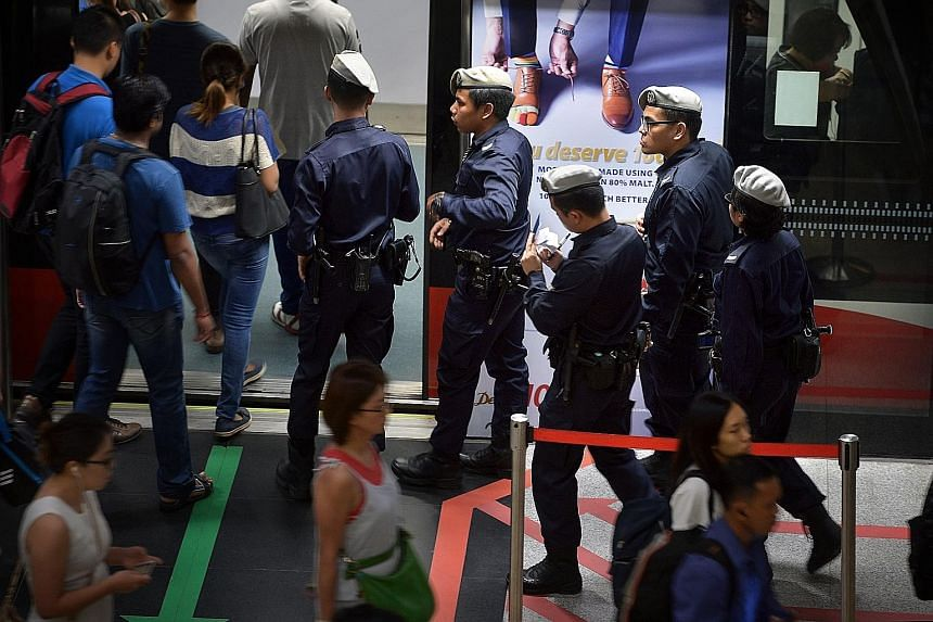 Public Transport Security Command officers at Bishan MRT station yesterday.