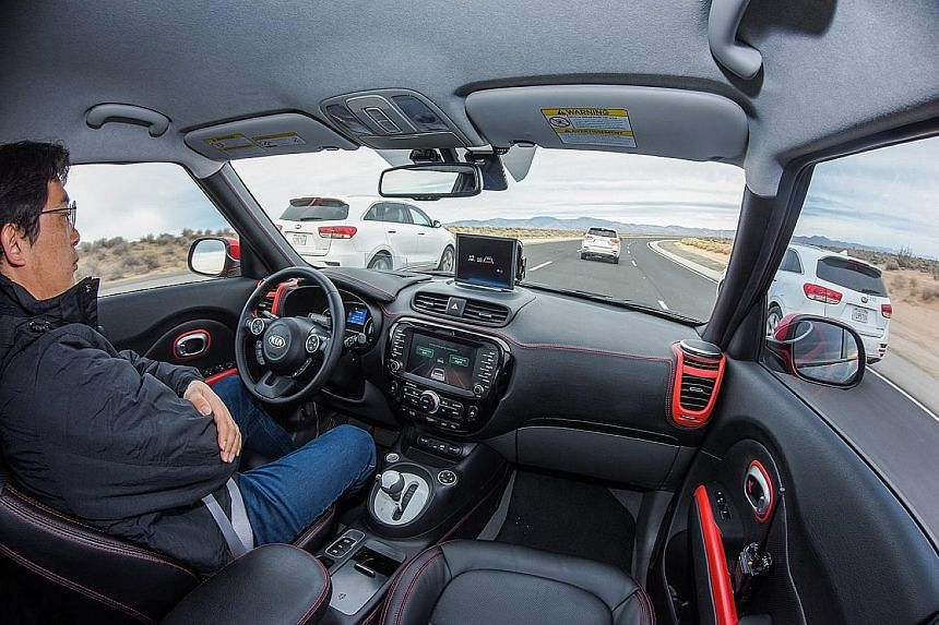 A Kia electric vehicle in autonomous driving mode during a test run. US Transportation Secretary Anthony Foxx said the government expects to issue guidance to firms within six months on what functions an autonomous vehicle must be able to perform to