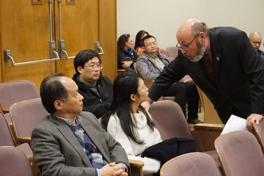 Former Stanford student Ouyang Xiangyu confers with her lawyer Jeffrey Hayden  in court during her sentencing in Palo Alto for poisoning two university labmates.
