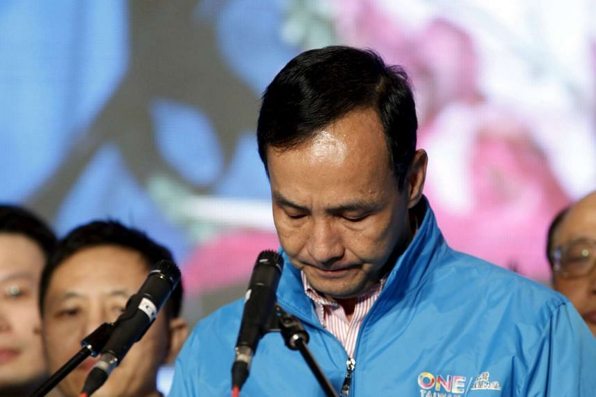 Kuomintang presidential candidate Eric Chu resigns as party chairman after losing the presidential election.