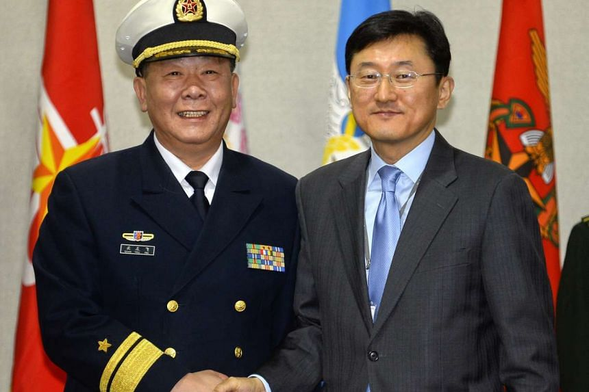 China's director-general for International Affairs Guan You Fei (left) with South Korea's director-general on International Policy Yoon Soon Ku prior to their meeting at the headquarters of the Defence Ministry in Seoul.