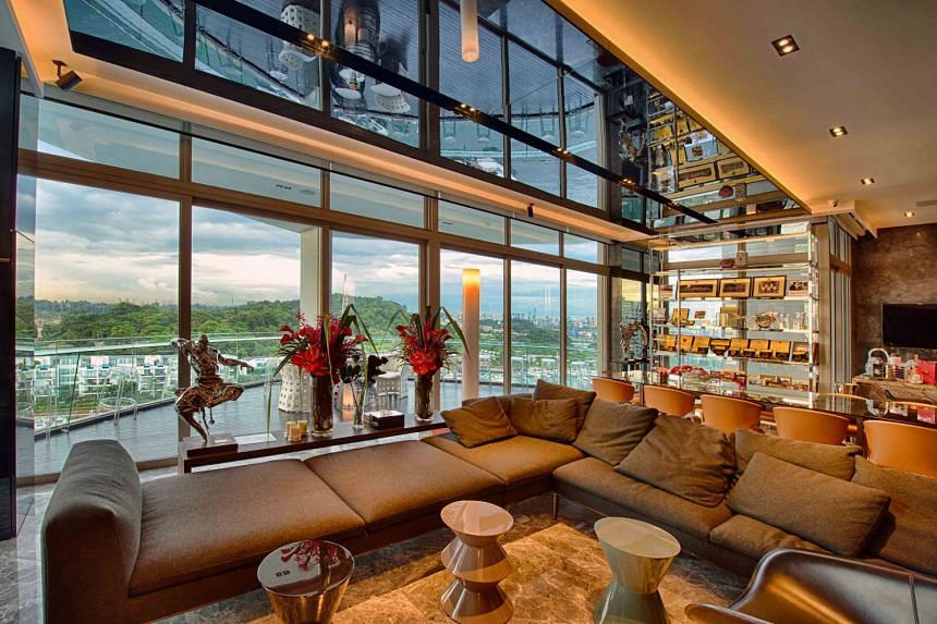 The living room (above) boasts a luxurious design by celebrity designer Peter Tay.