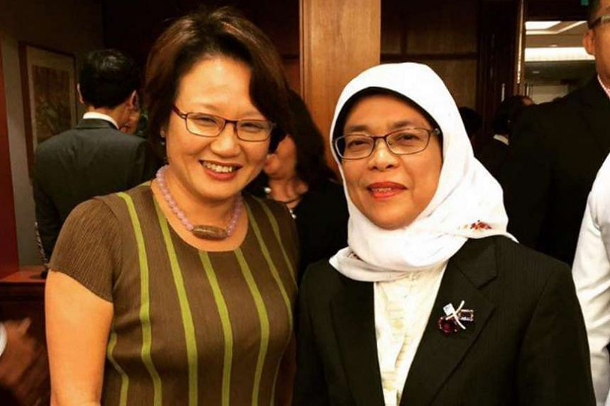 Ms Sylvia Lim (above, left) and Madam Halimah Yacob posing for a picture.