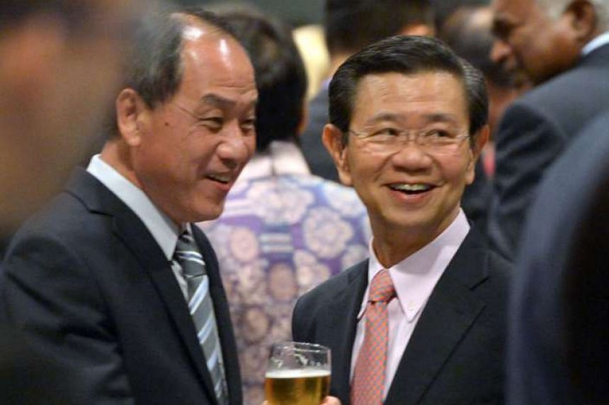 Mr Low Thia Khiang (Aljunied GRC), the Workers' Party chief, with former deputy prime minister Wong Kan Seng, who retired from politics last year.