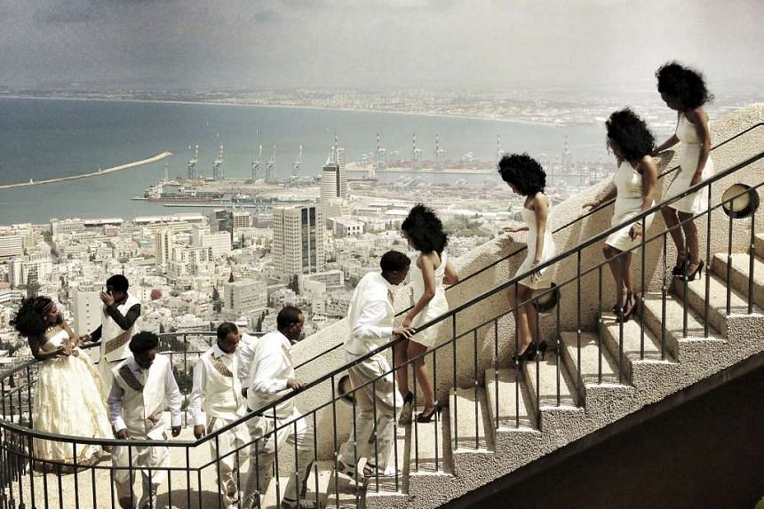 Third Prize, Daily Life Category, Singles. The wedding of an Eritrean couple, who came to Israel as refugees, being celebrated in Haifa.