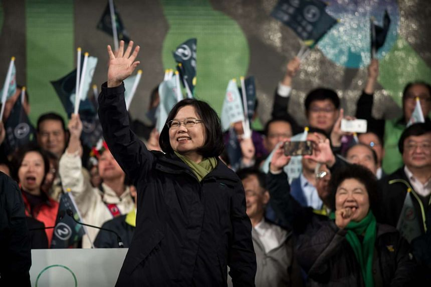 Democratic Progressive Party presidential candidate Tsai Ing-wen celebrates her victory in Taipei on Jan 16, 2016.