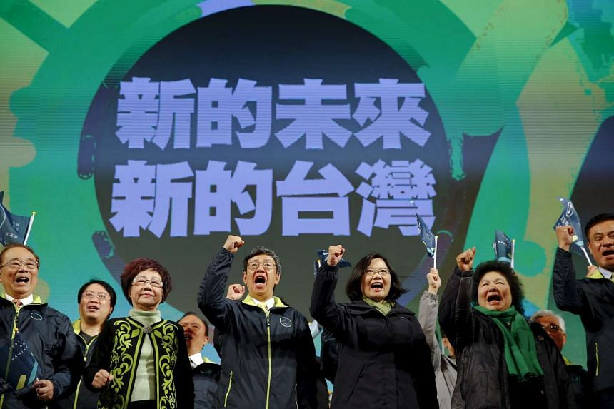 Democratic Progressive Party's Ms Tsai Ing-wen celebrates her election victory with party members.