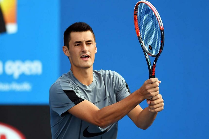 Bernard Tomic plays a forehand during a practice session at Melbourne Park on Jan 17, 2016.