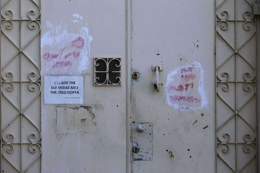 The remains of graffiti seen on a door of Dormition Abbey in the Old City of Jerusalem on Jan 17, 2016.