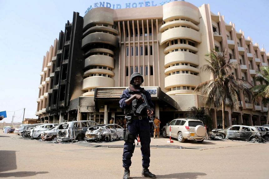 A soldier standing guard in front of the Splendid Hotel in Ouagadougou, Burkina Faso, on Jan 17, 2016.