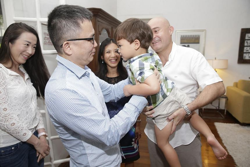 Adam Cabibel (2nd right), with father Christophe Cabibel (right), 48, and mother Mandy (centre), meets Dr Low Lee Yong (2nd left), accompanied by his wife Meek (left).