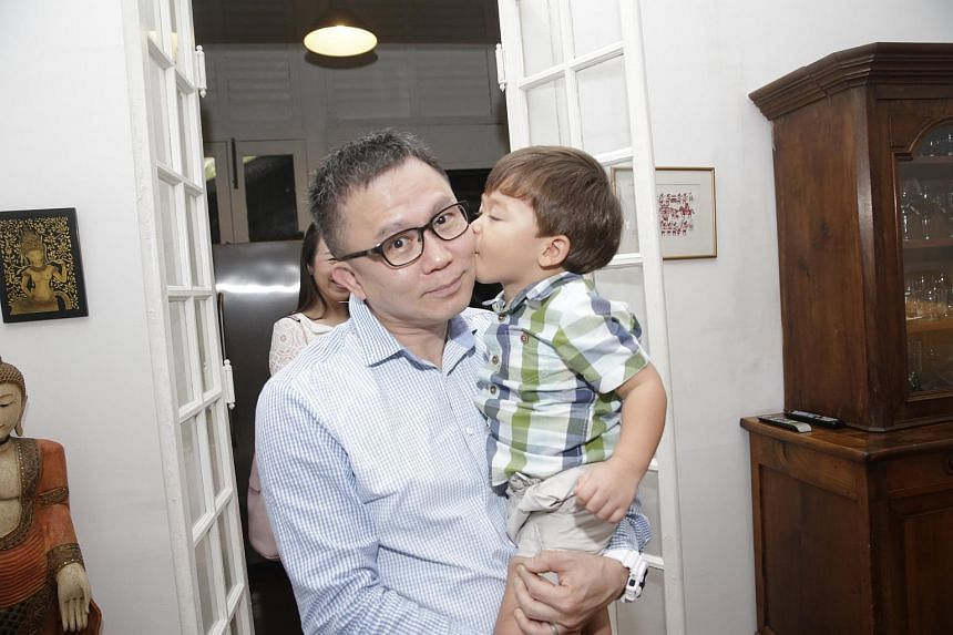 Adam Cabibel (right) kisses Dr Low Lee Yong.