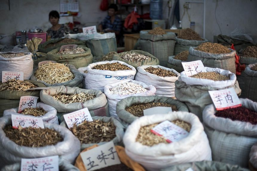 Various herbs and ingredients used in Chinese traditional medicine for sale at the Caizhuanyue Market in Yulin, China.