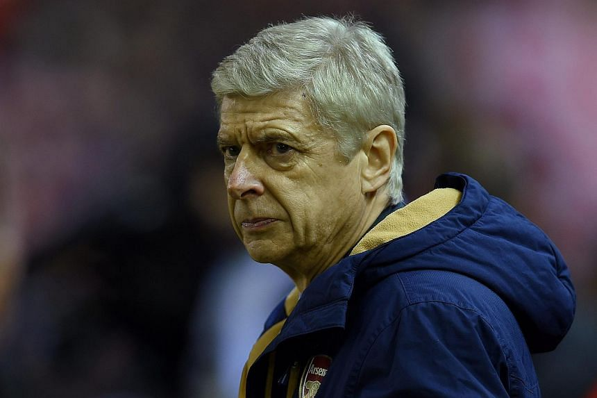 Arsenal manager Arsene Wenger reacts during the English Premier League soccer match at Liverpool, Britain, on Jan 13, 2016.