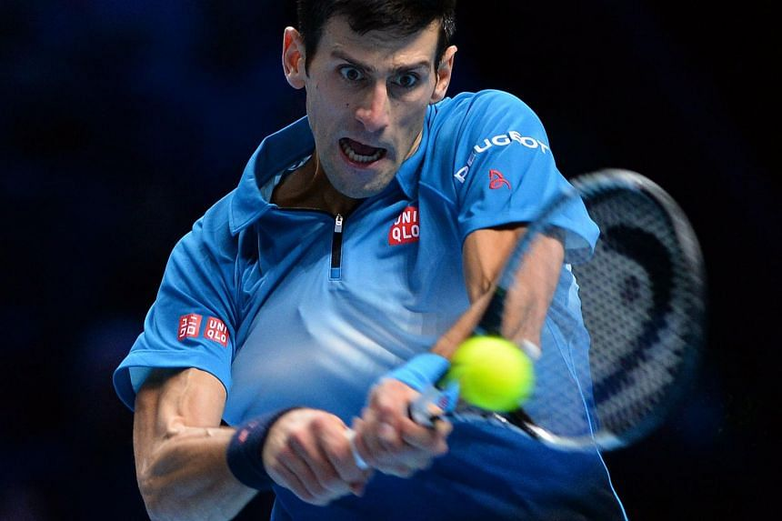 Serbia's Novak Djokovic returns to Switzerland's Roger Federer during the ATP World Tour Finals tennis tournament in London on Nov 22, 2015.