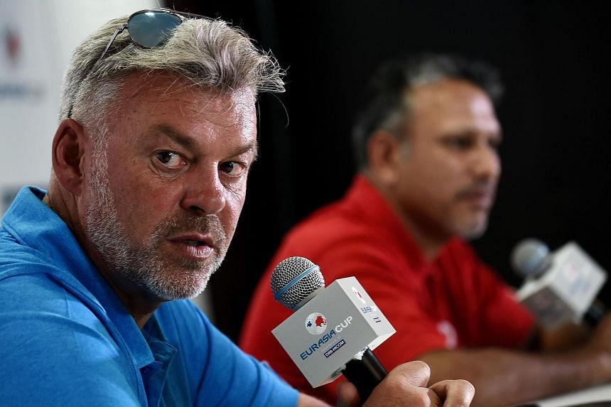 Team Europe captain Darren Clarke of Northern Ireland (left) answers questions from the media on Jan 12, 2016.