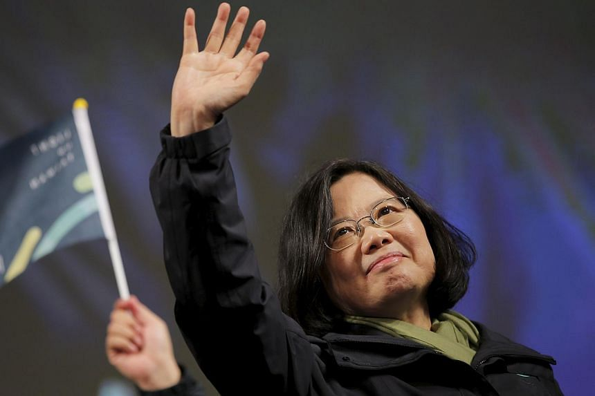 Tsai Ing-wen waves to supporters as she celebrates her election victory at the party's headquarters in Taipei.