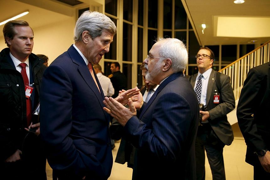 US Secretary of State John Kerry (left) talks with Iranian Foreign Minister Mohammad Javad Zarif following the nuclear deal, in Vienna, Jan 16, 2016.