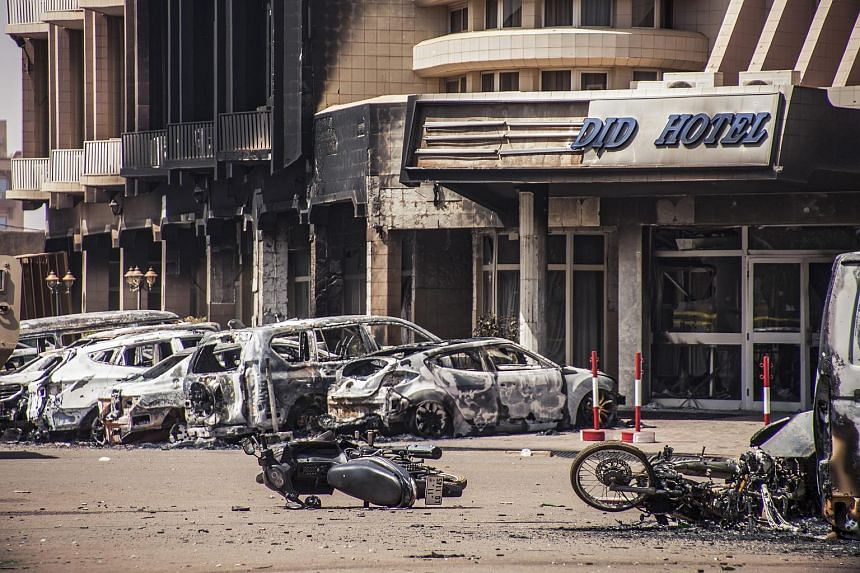 Damaged vehicles from two car bombs outside the Splendid Hotel in Ouagadougou, Burkina Faso, on Jan 16, 2016.