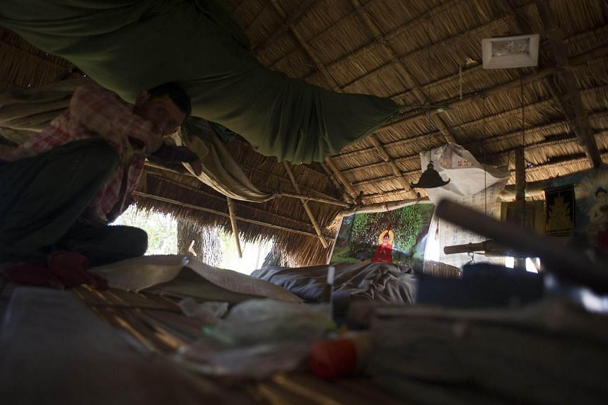A man living in a tree house at the Kyauk Ye village on the outskirts of Yangon.