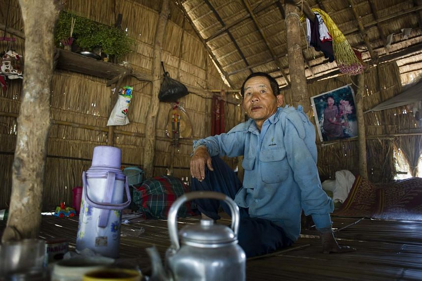 A man resting in his house at the Kyauk Ye village on the outskirts of Yangon.