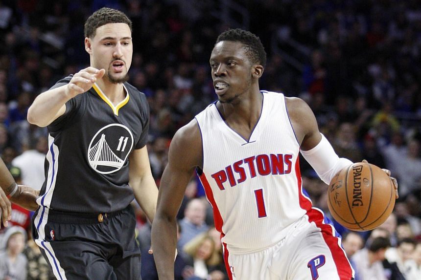 Detriot Pistons guard Reggie Jackson (right) dribbling past his Golden State Warriors counterpart Klay Thompson.
