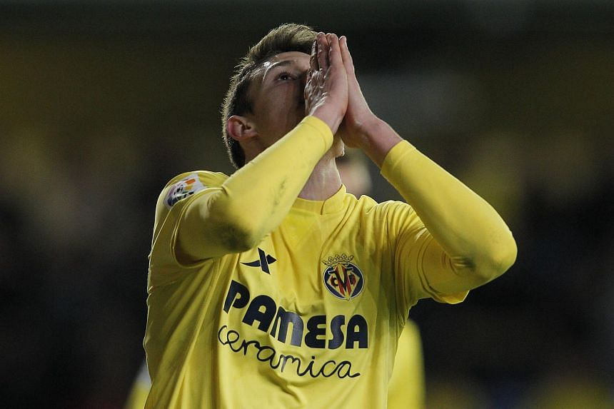 Villarreal's defender Adrian Marin reacts after missing an attempt on goal during the Spanish league football match between Villarreal CF vs Real Betis.