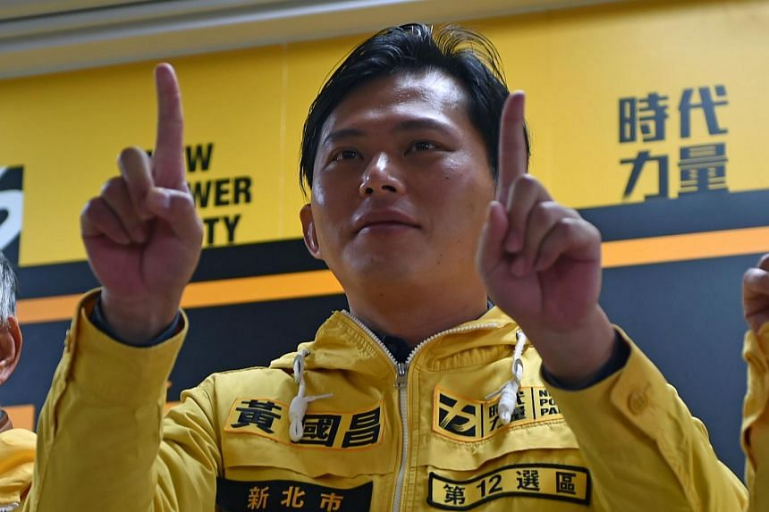 Academic and leader of the Sunflower Movement Huang Kuo-chang gestures during a press conference in Taipei on Jan 13, 2016.