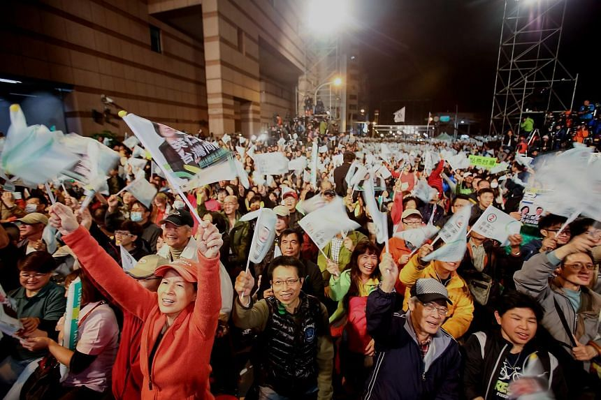 Democratic Progressive Party (DPP) supporters celebrate the election results as Tsai Ing-wen delivers her victory speech in Taipei.