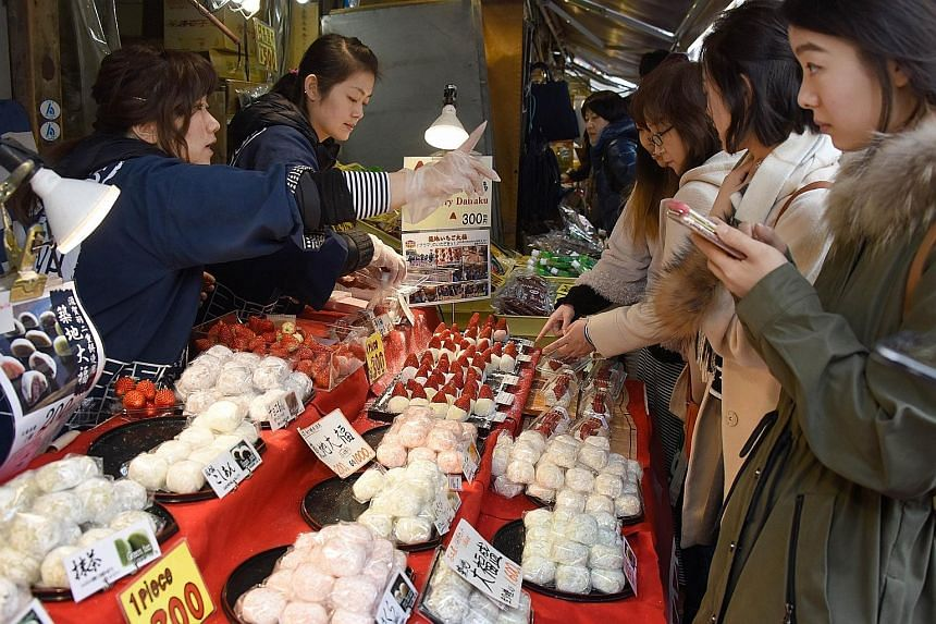 As persistent deflation turned into a source of low-level apprehension that limits ambition, Japan's young people get stressed over small price differences between shops and keep count of their savings in notebooks.