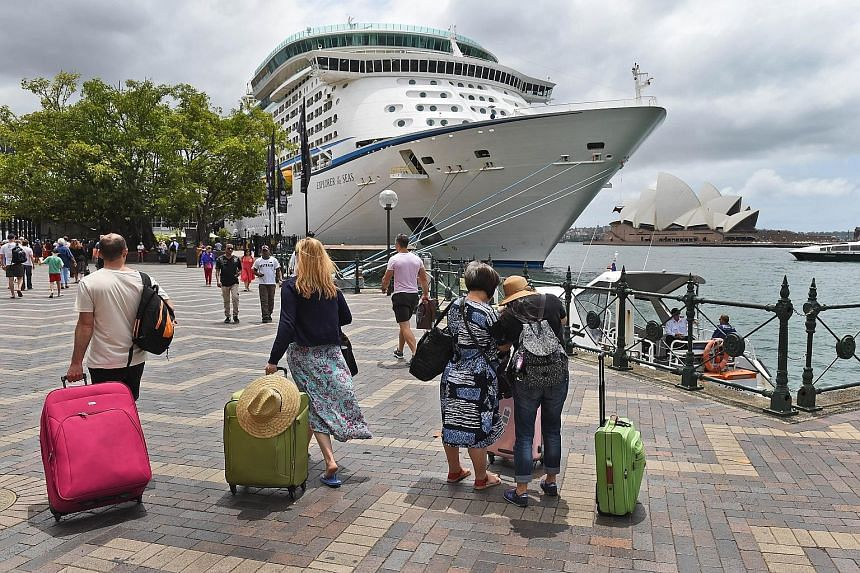 Reported outbreaks of gastrointestinal illness on cruises are not deterring passengers, such as these holidaymakers walking towards their cruise ship in Sydney last month. In Australia, the industry is the fastest growing part of the tourism sector.