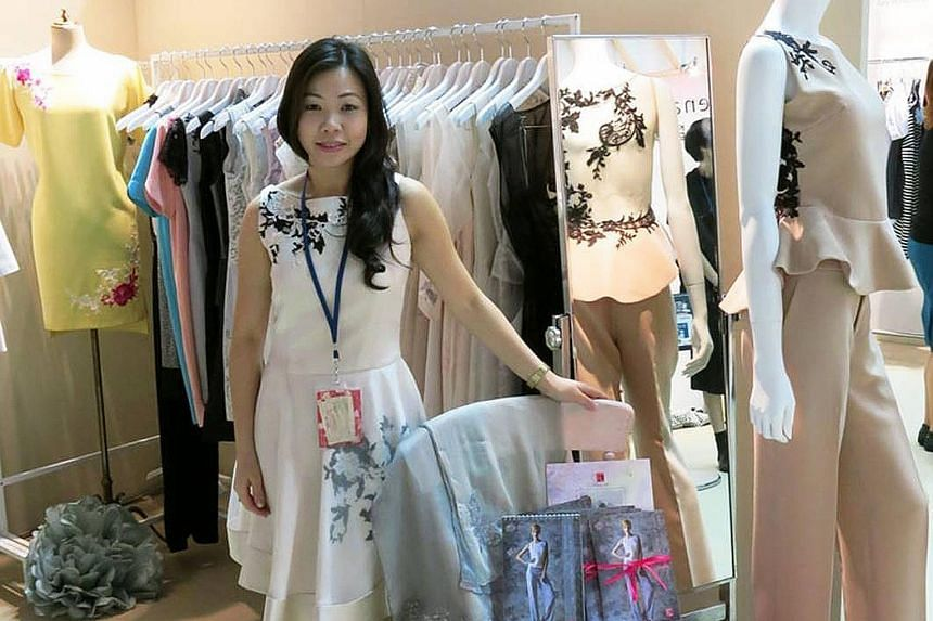 (Left picture) Ms Lin with the designs she took along when she staged a show in Tokyo in 2013. Her dream is to expand her label outside of Singapore. Ms Lin and her husband, Gary Ong, with then President S R Nathan at the Istana in 2010, where they r