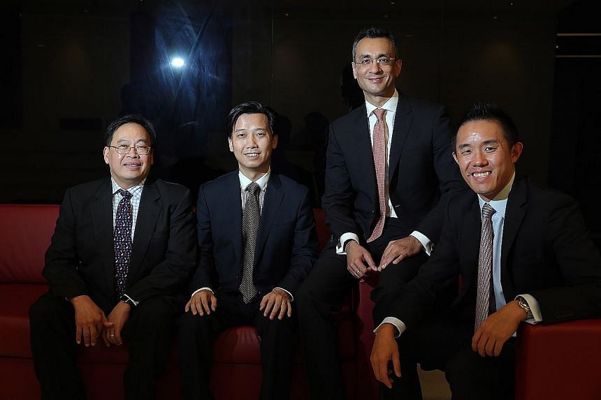 Helping to build the customised investment portfolios in the new Save and Invest Portfolio series are (from left) Mr Phoon Chiong Tuck, Mr Jack Wang, Mr Praveen Jagwani and Mr Simon Ng.