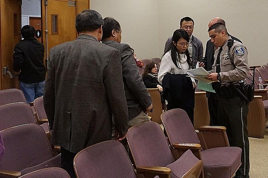 """A court bailiff giving former Stanford student Ouyang Xiangyu instructions after her sentencing. She pleaded """"no contest"""" to four counts of poisoning her former laboratory mates at the university."""