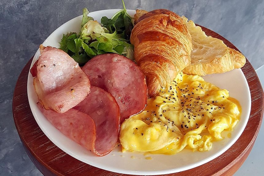 All-day breakfast platter (weekend only, $13.90 each) with ham and bacon, or sausages with scrambled egg and croissant.