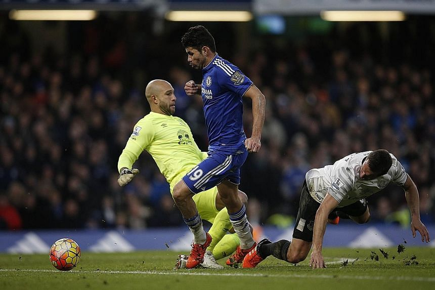 Diego Costa (centre) started Chelsea's comeback from two goals down. The striker, chasing down a long ball with Everton defender Phil Jagielka (right), manages to evade goalkeeper Tim Howard and put the ball into an empty net.