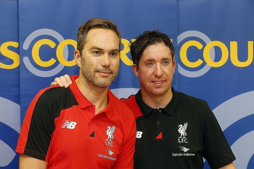 Robbie Fowler (in black) and Jason McAteer at New Balance and Courts events yesterday.