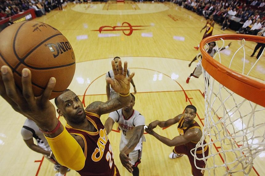 Cavaliers' LeBron James driving to the basket against the Rockets. Cleveland won the game 91-77, with Houston recording a season-low point total.