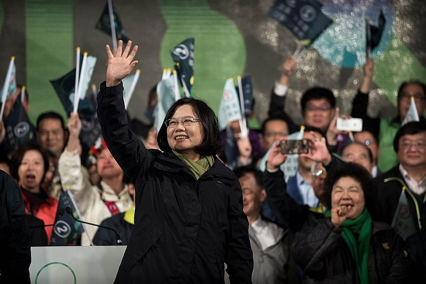 President-elect Tsai Ing-wen celebrating her victory in Taipei yesterday. The results were a stunning indictment of President Ma Ying-jeou's KMT.