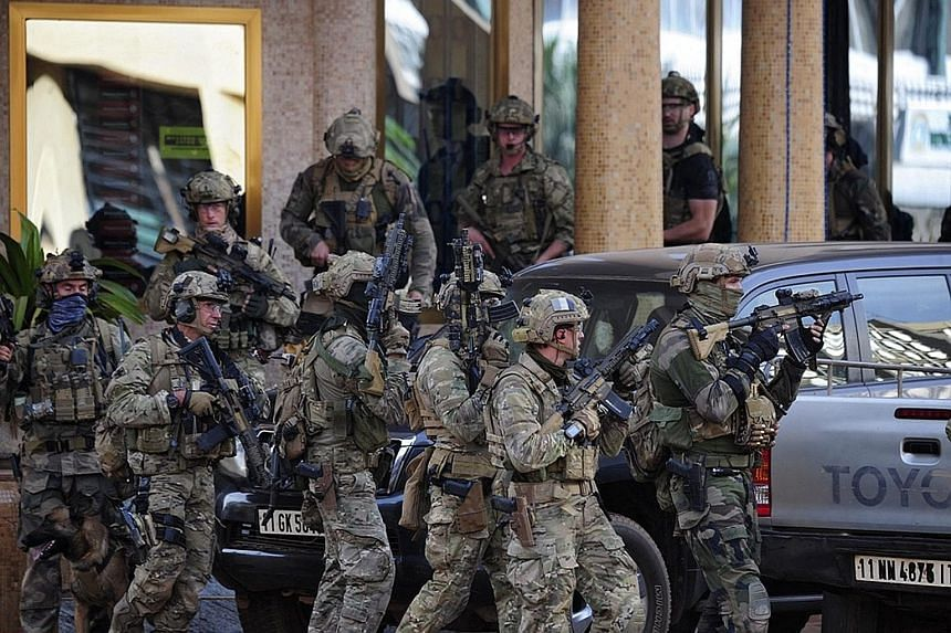 French forces outside the Splendid hotel in Ouagadougou, Burkina Faso, yesterday. People from 18 countries were rescued from the site of the attack duringan operation that received support from French and United States forces.