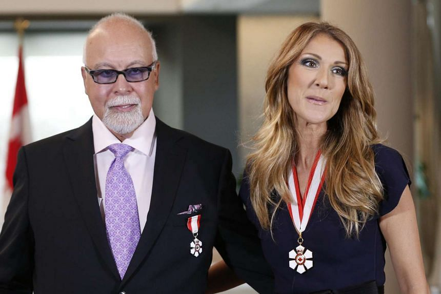 Celine Dion and her husband Rene Angelil in a 2013 file photo.