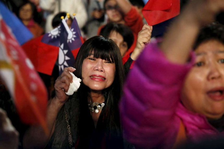 A Kuomintang supporter breaks down in tears after Eric Chu concedes defeat in Taiwan's presidential election.