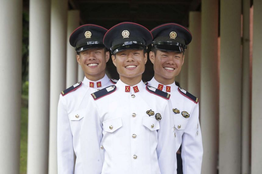 Identical triplets Phuah Wei Ke, Phuah Wei Deng, and Phuah Wei Yuan, at the 99/15 Officer Cadet Course Commissioning Parade on Jan 17, 2016 at Safti Military Institute.