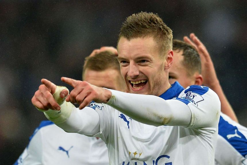 Leicester City's Jamie Vardy reacts after Japanese striker Shinji Okazaki (not pictured) scores.