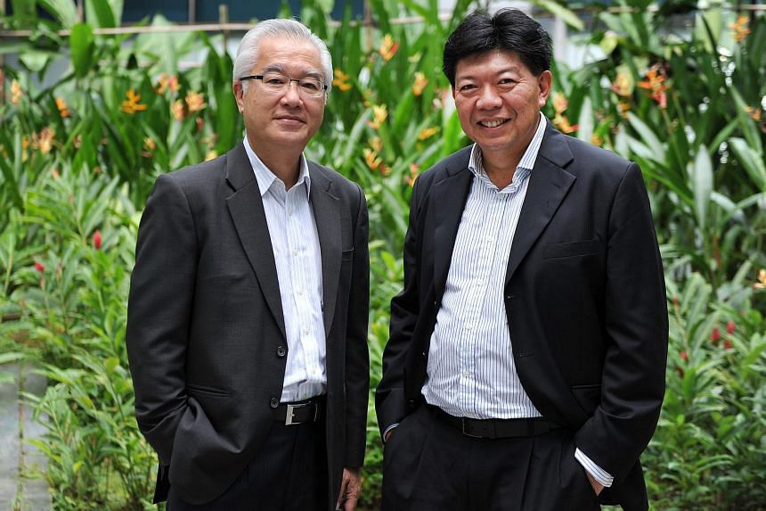 GS Holdings' executive chairman and CEO Pang Pok (left), with chief finance officer Kenneth Foo (right).