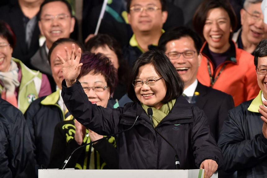 President-elect Tsai Ing-wen (centre) of the Democratic Progressive Party (DPP) waves after her victory in the presidential election in Taipei on Jan 16, 2016.
