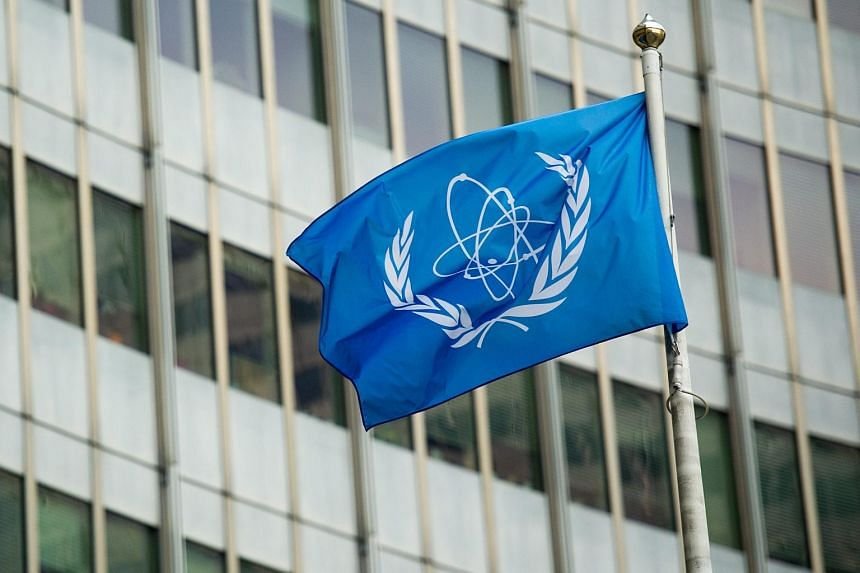 The flag of the International Atomic Energy Agency (IAEA) flies in front of the UN seat.
